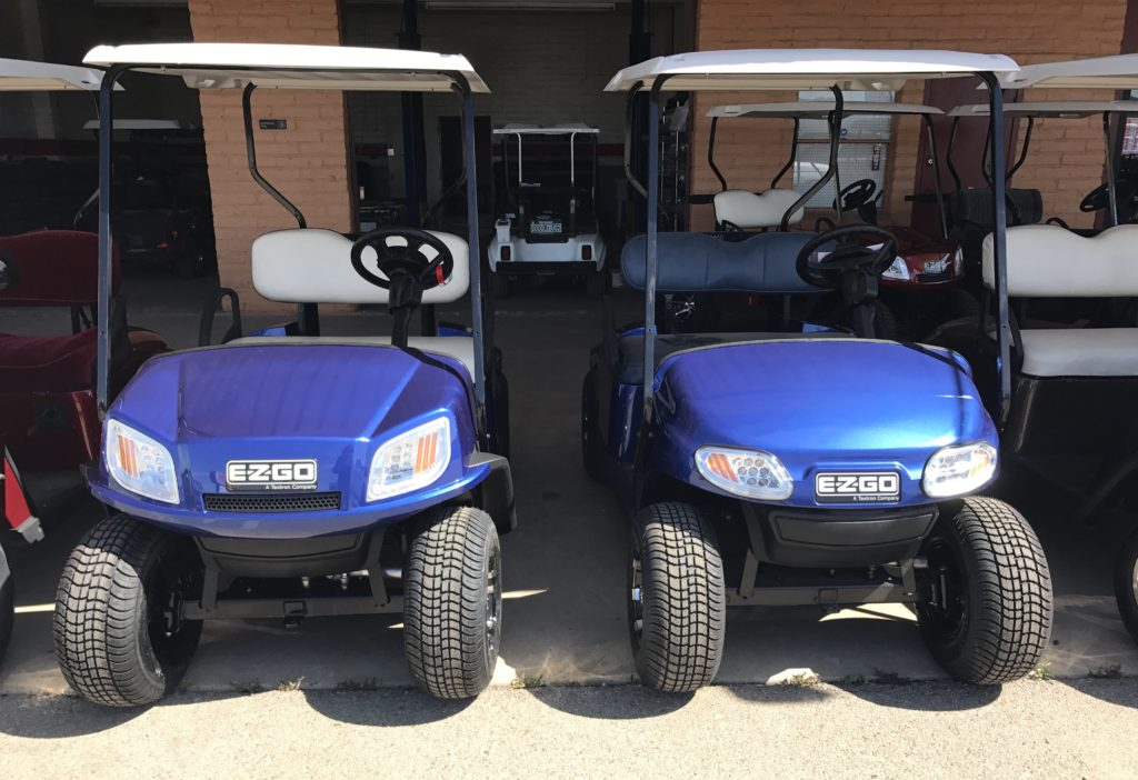 blue golf cars seen from front